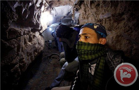 A Palestinian works inside a smuggling tunnel flooded by Egyptian forces, beneath the Egyptian-Gaza border in Rafah, in southern Gaza, Feb. 19
