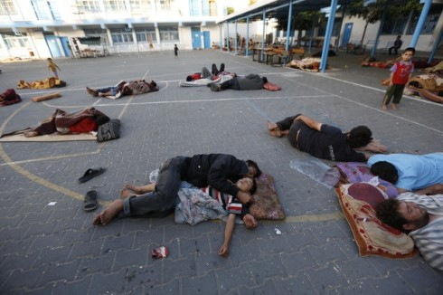 Palestinians sleep at the yard of a UN school in the northern Gaza Strip town of Beit Lahiya