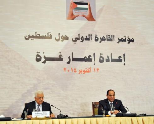 Palestinian President Mahmoud Abbas, left, meets Egyptian President Abdel-Fattah el-Sissi in Cairo