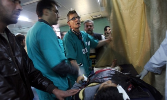 Norwegian Dr. Mads Gilbert, center, tends to a patient wounded in an Israeli army operation in the emergency area at Shifa hospital in Gaza City, Monday, Jan. 5, 2009. The Norwegian medical doctor was allowed to cross into Gaza last week to assist with casualties in Israel's military operations in Gaza. Israel seized control of high-rise buildings and attacked houses, mosques and smuggling tunnels as it pressed forward with its offensive against the Gaza Strip's Hamas rulers on Monday, even as a stream of European leaders headed for the region to press for a truce. (AP Photo/Khalil Hamra)
