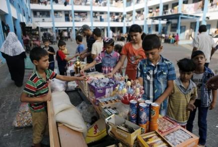 Gaza children buy Eid sweets