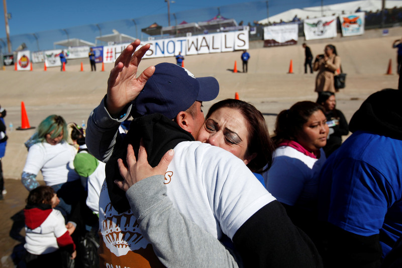 """Relatives separated by deportation and immigration hug at the border during a reunification event named """"#Hugs Not Walls"""" at the banks of the Rio Bravo, a natural border between U.S. and Mexico, January 28, 2017. REUTERS/Jose Luis Gonzalez (Newscom TagID: rtrleight522263.jpg) [Photo via Newscom]"""